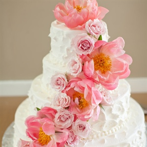 More fresh pink roses and peonies cascaded down the buttercream-frosted cake.