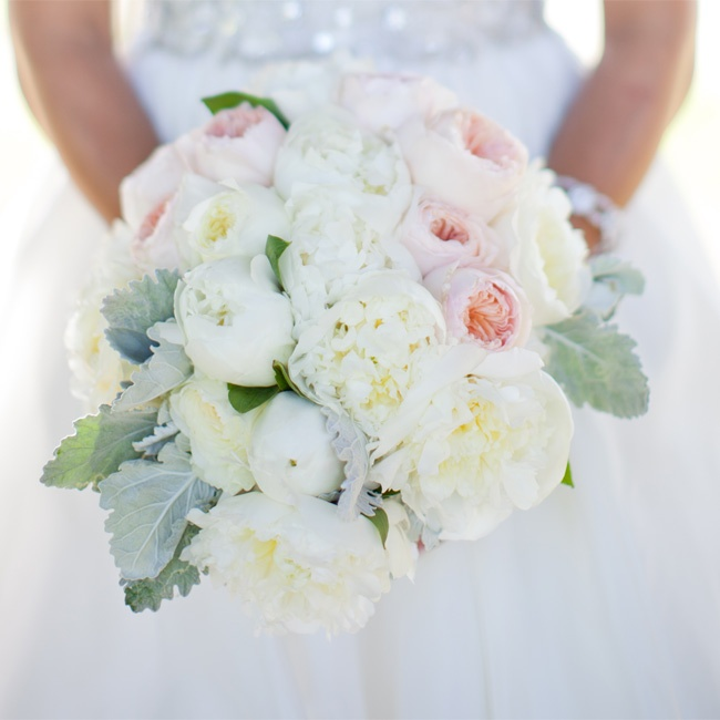 White and blush-pink peonies and garden roses were accented with dusty miller in Bianca's bouquet.