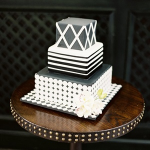 The modern black-and-white-fondant cake was accented with sugar flowers.