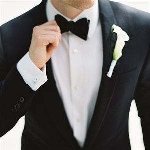 Both grooms wore classic black tuxedos and white mini calla lily bouts.