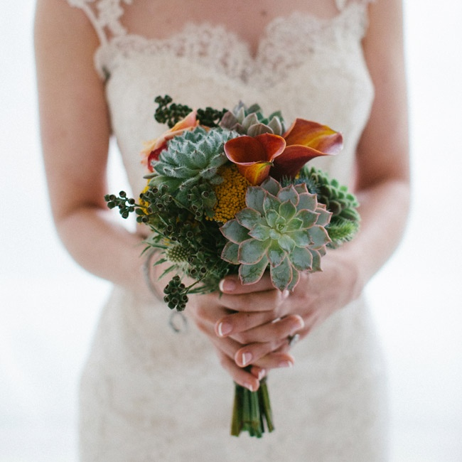 Because of her love of succulents, Debra held a green succulent bouquet with calla lilies added in.