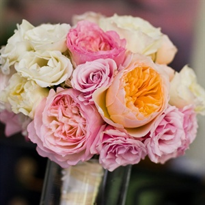 Lauren carried a bouquet of pink, ivory and peach roses.