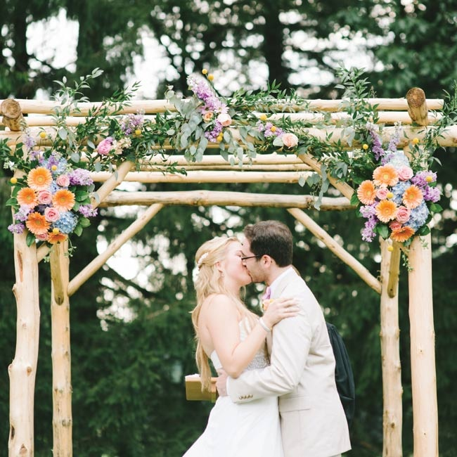 Emily's uncle built the ceremony arbor, and the couple's florist finished it off with beautiful arrangements.