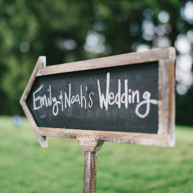 Wooden chalkboard signs directed guests to the wedding ceremony.