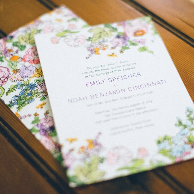 A colorful floral design decorated the couple's wedding invitations.