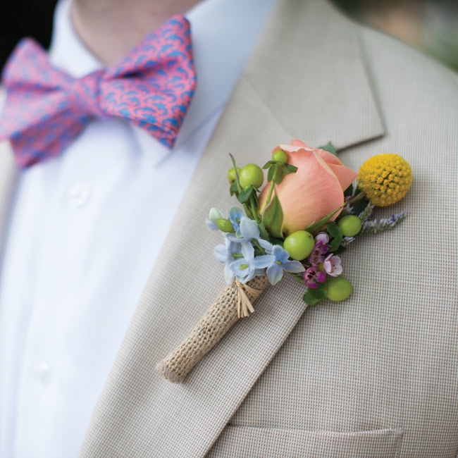 Noah wore a small rose blossom accented with billy balls and green berries.