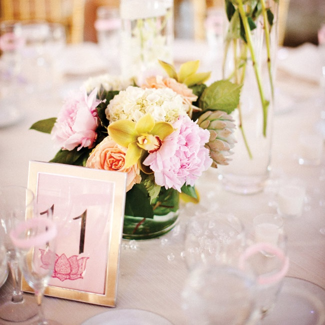Varying shapes and sizes of glass vases were filled with peonies, hydrangeas, roses and orchids.