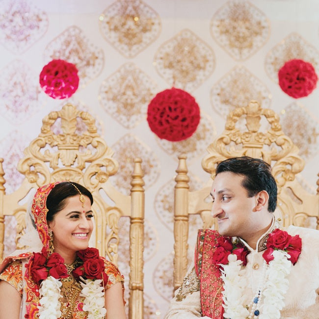 For the couple's wedding ceremony, Shital wore a vibrant orange-and-red floral lehenga. Darshan's sherwani matched.