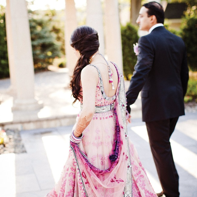 "Of her reception outfit, Shital says, ""I felt like a princess."" She wore her hair pulled to the side with curls."