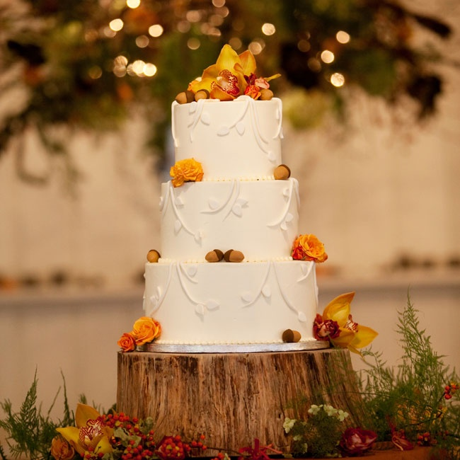Fresh orchids and roses topped the white cake. Fondant acorns added a fun fall touch.