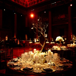 The dramatic centerpieces were uplight by tables full of candles. Small votives hung from the branches for an ethereal vibe in the regal Capitale venue.