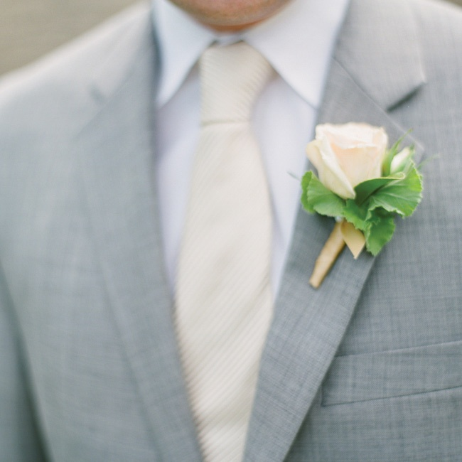 The guys wore a single rose blossom and geranium leaves on their lapels.