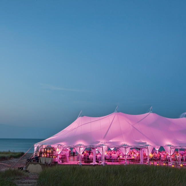Purple uplighting set a dramatic, romantic vibe in the reception tent.
