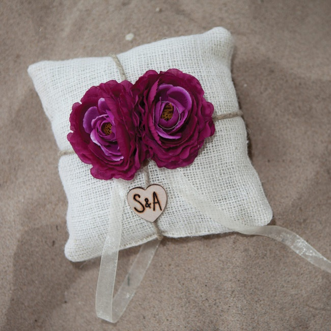 Purple flowers decorated the burlap ring pillow.