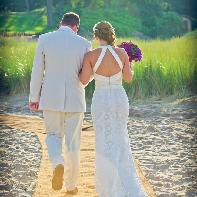 Savana wore an elegant handmade lace and silk halter dress. Adam chose a beach-friendly khaki suit.