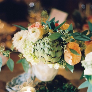 Mixed arrangements of peach, white and orange flowers rested beside small pumpkins and votives on birch risers.