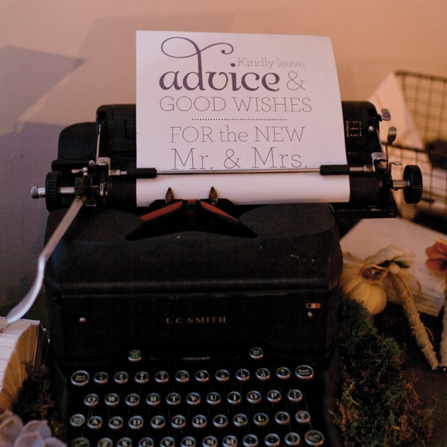 Guests left their best wishes and advice for the couple on a table decorated with an old typewriter.