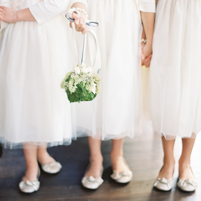 Megan's cousins served as flower girls and wore white tulle dresses with peach flower pins.