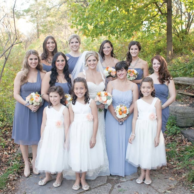 All of the bridesmaids wore deep-mauve-colored dresses in their chosen style.