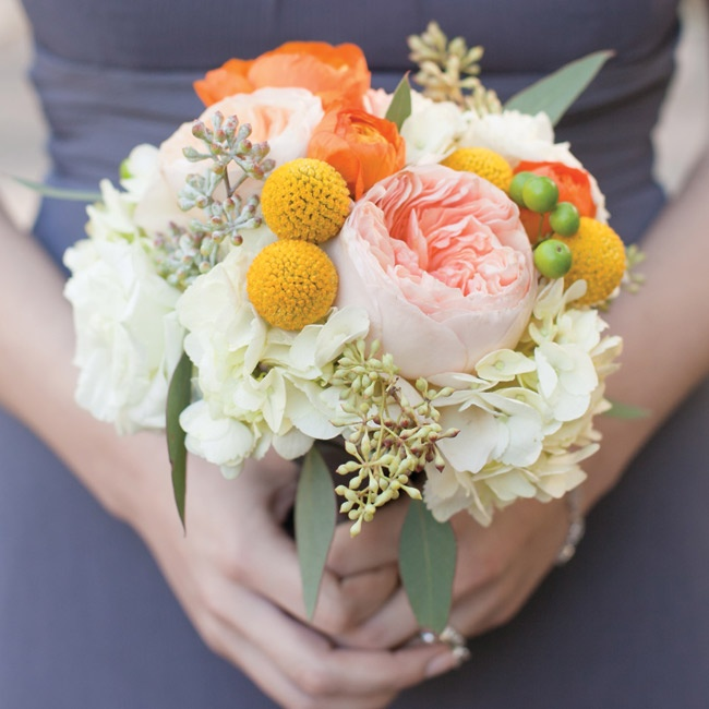 The girls carried textured bunches of garden roses, billy balls, ranunculus, berries and hydrangeas.