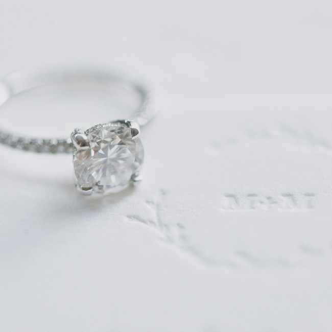 Mike proposed with this solitaire diamond ring that has a pavé diamond band.