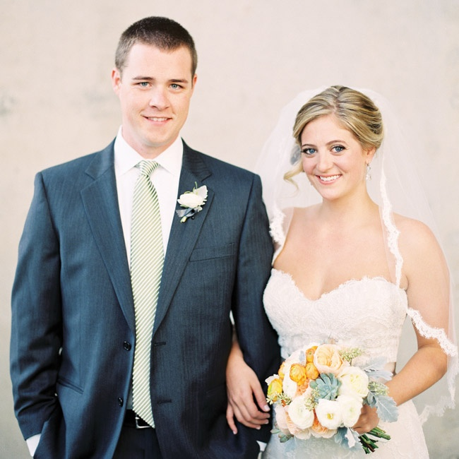 Megan wore a romantic French-quartered lace gown with a lace-and-tulle veil. Mike chose a dark-gray suit and a simple striped tie.