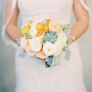 Megan carried a romantic bunch of white, peach and orange ranunculus, garden roses and succulents.