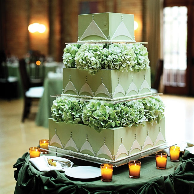 Each tier of the pale-green cake was separated with fresh green hydrangeas.