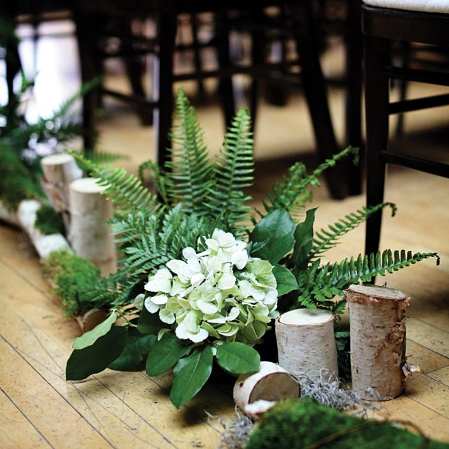 Hydrangeas, ferns, green leaves and birch blocks lined the ceremony aisle.