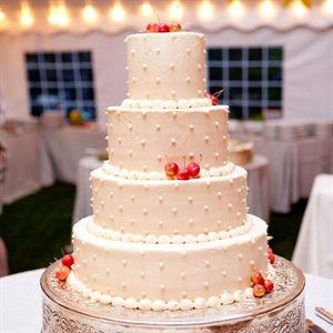 Crabapples topped the simple ivory wedding cake.