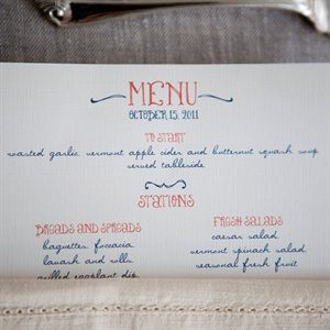Script-like burnt-orange and navy fonts decorated the otherwise simple menus.