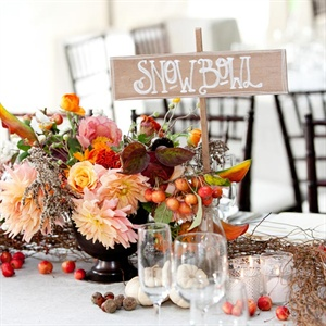 Rustic arrangements were crafted with roses, calla lilies, pumpkins, apples, leaves and branches. The tables were named after ski mountains in Vermont.