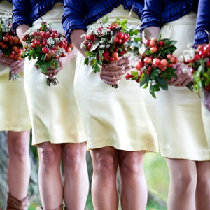 The bridesmaids carried bouquets of red ilex berries, or holly.