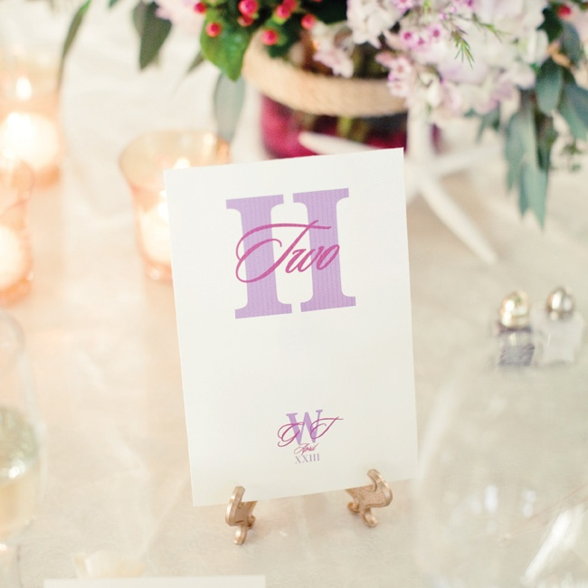 The simple, elegant table numbers featured different lavender fonts and the couple's monogram.