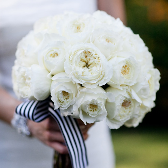 Veronica carried a white rose bouquet held together with black-and-white-striped ribbon.