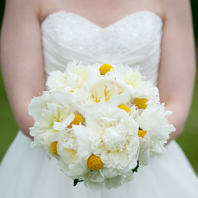 Brittany wanted a simple bouquet with subtle yellow accents. Her florist delivered with a bouquet of white hydrangeas, billy balls and white peonies.