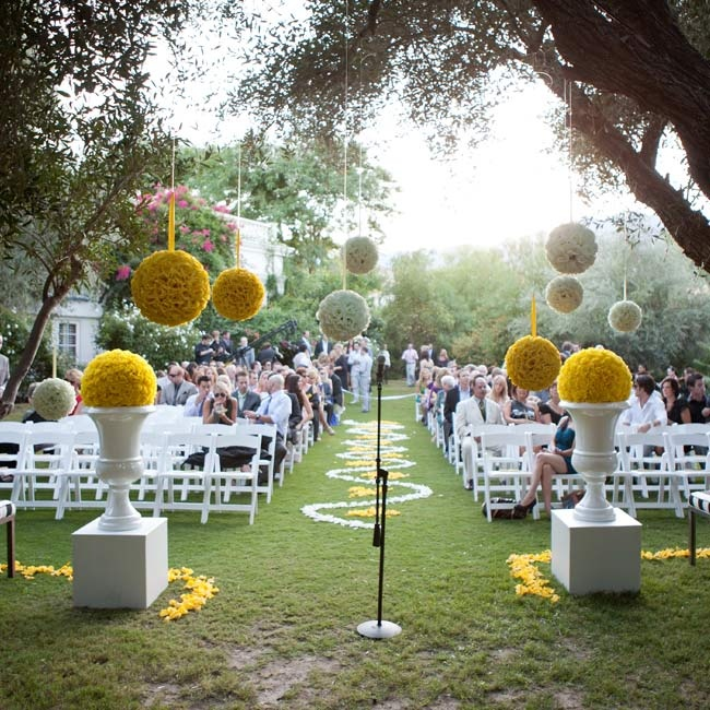 White and yellow pomanders hung from the trees surrounding the croquet lawn during the sunset ceremony.