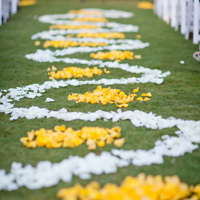 White and yellow rose petals lined the aisle.