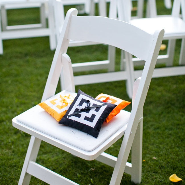 Small colorful pillows rested atop some of the guest chairs.