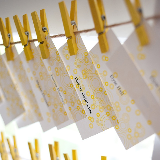 Brittany and John found the clothespins at a local craft store, and John gathered a few friends to help him paint each one. To keep the look cohesive, their printer was able to take the graphics from the invitation and create matching escort cards.