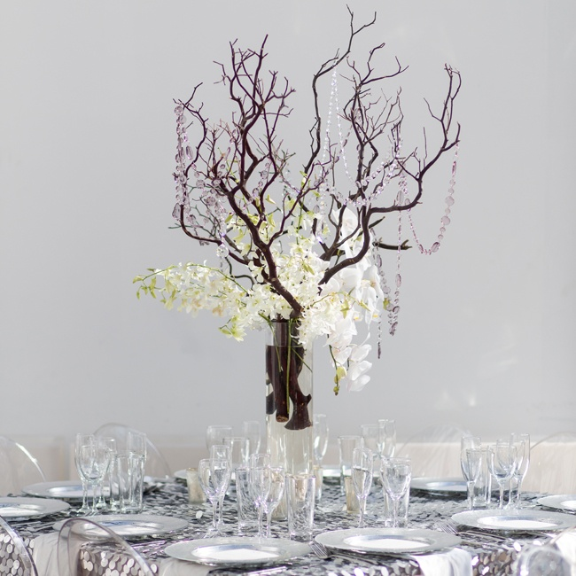 This floral style really completed the winter wonderland look of a Modern Ice Castle wedding.