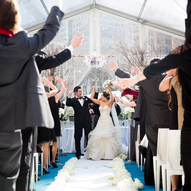 "Guests wanted to surprise the newlyweds so after the couple exchanged their vows the crowd all got up and danced to ""Your Life Keeps Lifting Me Higher."""