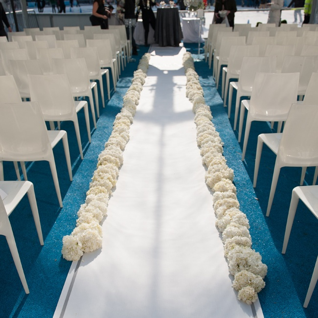 The ceremony aisle was lined with lush white flowers by Rebecca Shepherd Floral Design.