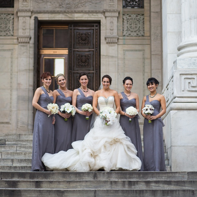 Sierra wore a Pnina Tornai gown and her bridesmaids wore Amsale dresses in graphite. We love the subtle peplum detail!