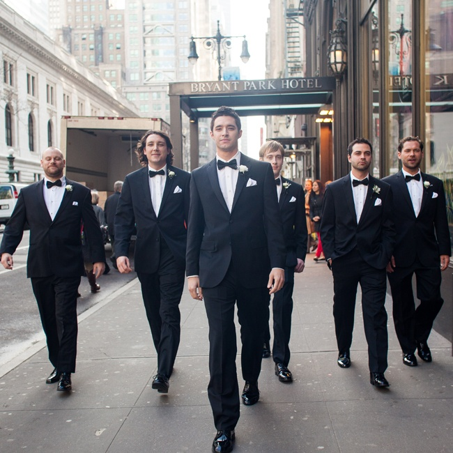 The groomsmen look sharp in BLACK by Vera Wang tuxedos and black bowties.