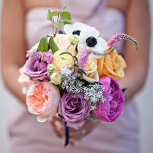 The bridesmaids carried bouquets filled with garden roses, ranunculus, anemones and gooseneck.