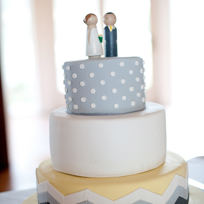 The couple chose two flavors for their wedding cake: a chocolate layer with peanut butter buttercream for John and a caramel layer with caramel buttercream for Brittany. The cake toppers, by Etsy seller IttyBittyWoodShoppe, were custom made to look like the couple.