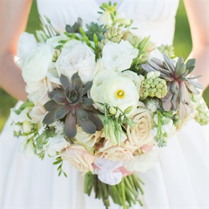 Masculine succulents mixed with feminine garden roses made the perfect combination.