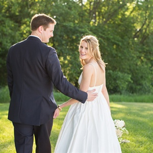 MaryKate's Italian silk gown from J.Crew was the perfect complement to the groom's custom Tom James three-piece suit.