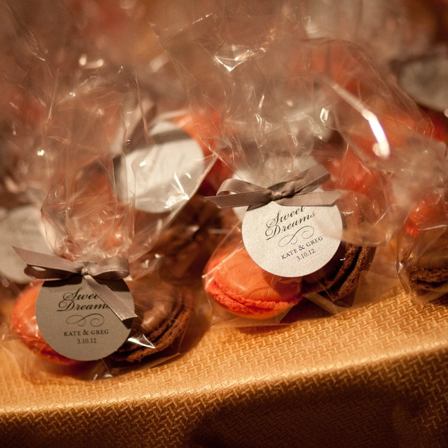 Kate and Greg wanted their guests to leave with something sweet at the end of the night. One of their first trips together was to Paris so they incorporated French macarons from Bonjour Bakery into the wedding. Jenifer Sirkis Designs created the personalized labels.
